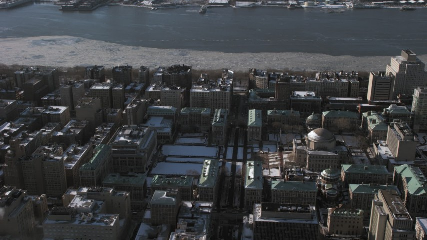 5K stock footage aerial video of the snowy Columbia University campus in New York City Aerial Stock Footage | AX66_0095