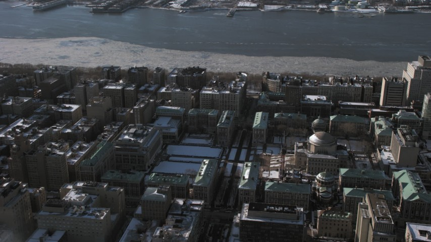 Columbia University campus with snow, Morningside Heights New York City Aerial Stock Footage | AX66_0096