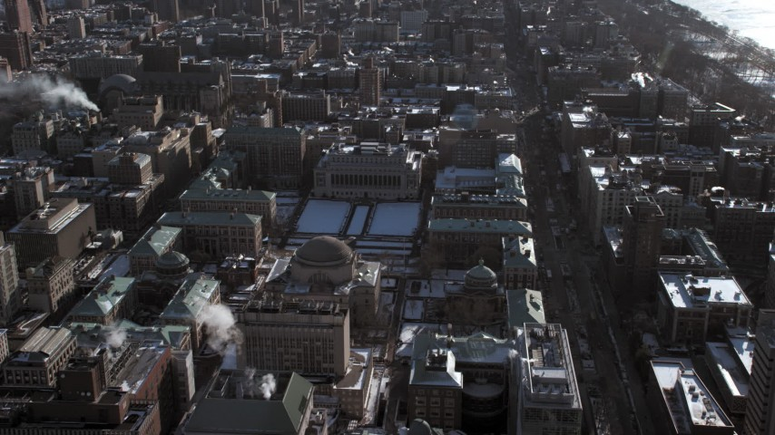 5K stock footage aerial video of approaching Columbia University grounds with snow, New York City Aerial Stock Footage | AX66_0099