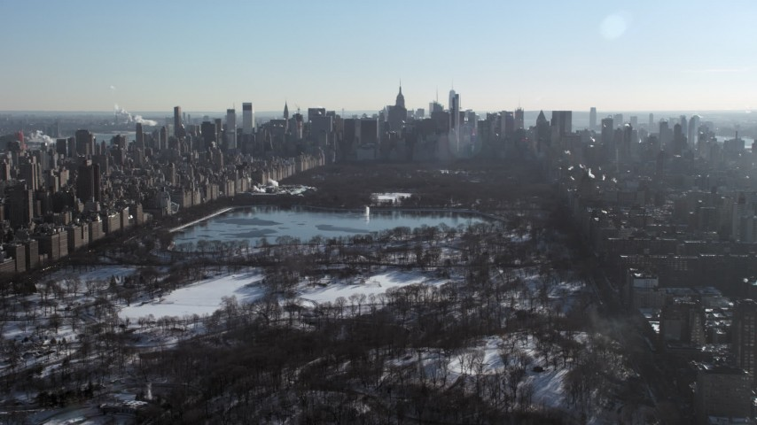 5K stock footage aerial video of a wide view of Central Park in snow and Midtown Manhattan, New York City Aerial Stock Footage | AX66_0101