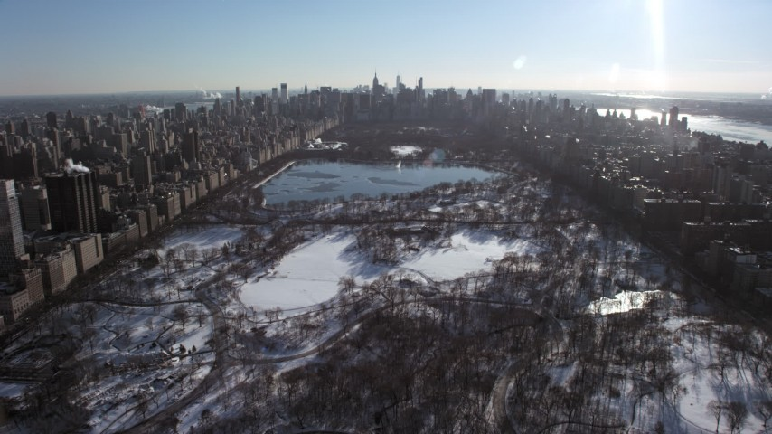 5K stock footage aerial video fly over snowy Central Park toward Midtown, New York City Aerial Stock Footage | AX66_0102