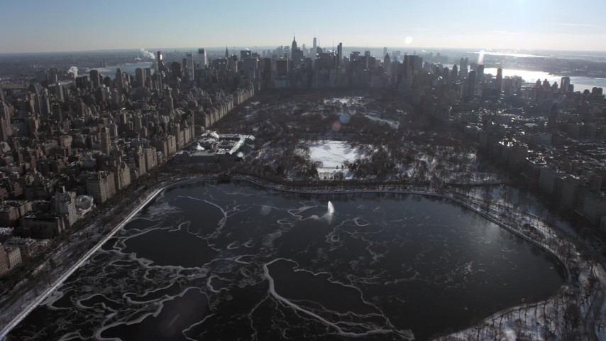 5K stock footage aerial video fly over Central Park toward Metropolitan Museum of Art with snow, New York City Aerial Stock Footage | AX66_0104