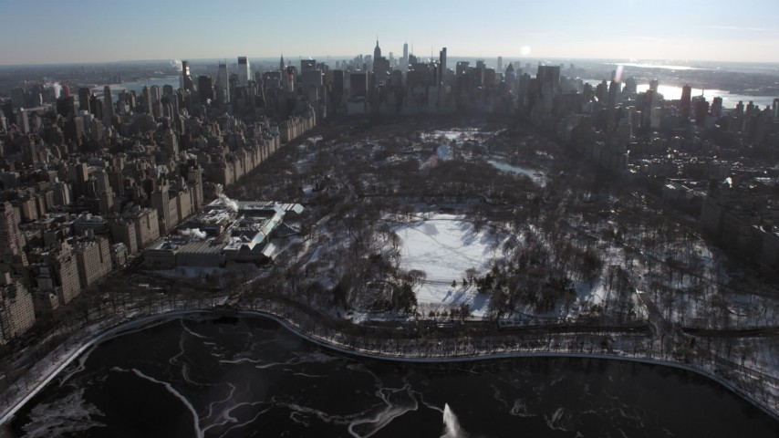 Central Park Metropolitan Museum of Art with snow, New York City Aerial Stock Footage | AX66_0105