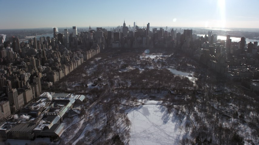 5K stock footage aerial video fly over snowy Central Park and the Metropolitan Museum of Art toward Midtown, New York City Aerial Stock Footage | AX66_0105