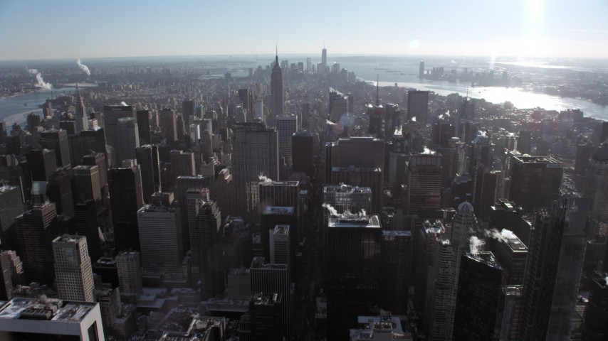 5K stock footage aerial video fly over Midtown Manhattan toward the Empire State Building, New York City Aerial Stock Footage | AX66_0109