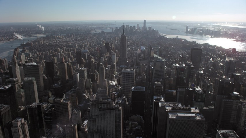 5K stock footage aerial video fly over Midtown skyscrapers toward the Empire State Building, New York City Aerial Stock Footage | AX66_0110