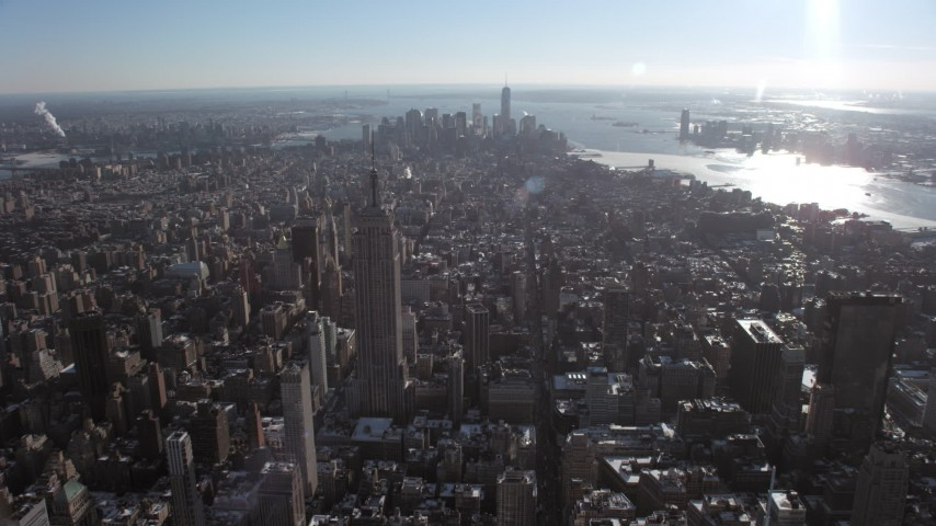 5K stock footage aerial video approach Empire State Building with view of Lower Manhattan, New York City Aerial Stock Footage | AX66_0112