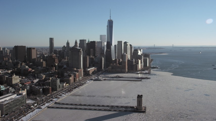 5K stock footage aerial video of World Trade Center Skyscrapers by icy Hudson River, New York City Aerial Stock Footage | AX66_0118