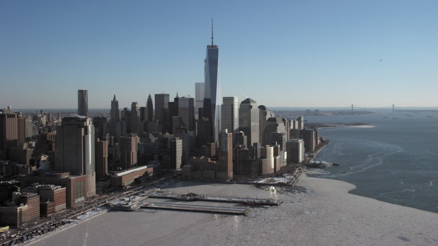 5K stock footage aerial video of World Trade Center skyscrapers overlooking icy Hudson River, New York City Aerial Stock Footage | AX66_0119