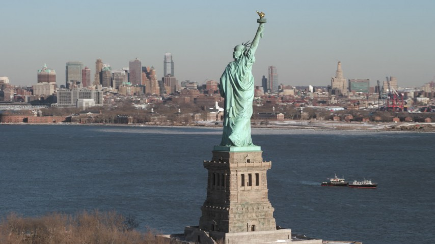 5K stock footage aerial video of the famous Statue of Liberty with snow, New York Aerial Stock Footage | AX66_0129