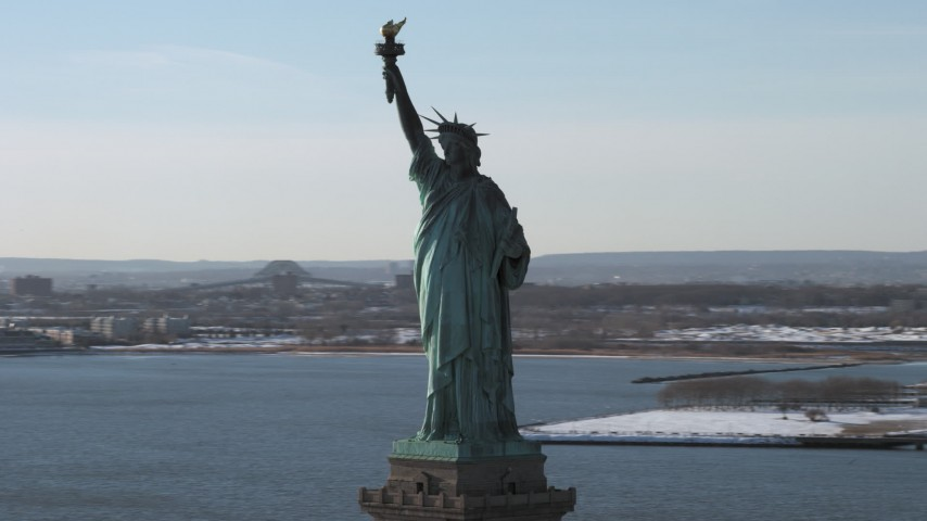 5K stock footage aerial video of an orbit of the Statue of Liberty in winter, New York Aerial Stock Footage | AX66_0132