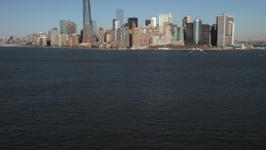 5K stock footage aerial video tilt from New York Harbor to reveal skyline in Lower Manhattan, New York City Aerial Stock Footage | AX66_0133