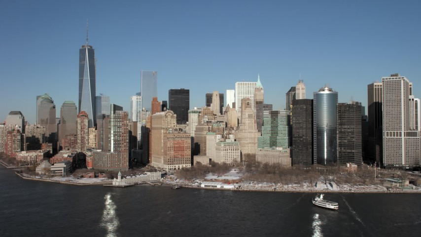 5K aerial video approach Battery Park in snow in Lower Manhattan, New York City Aerial Stock Footage | AX66_0135