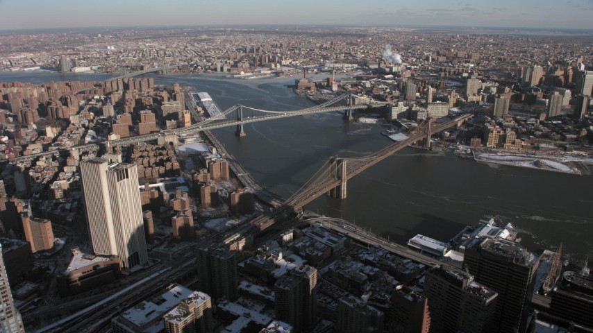 5K stock footage aerial video of Brooklyn Bridge and Manhattan Bridge, New York City Aerial Stock Footage | AX66_0140