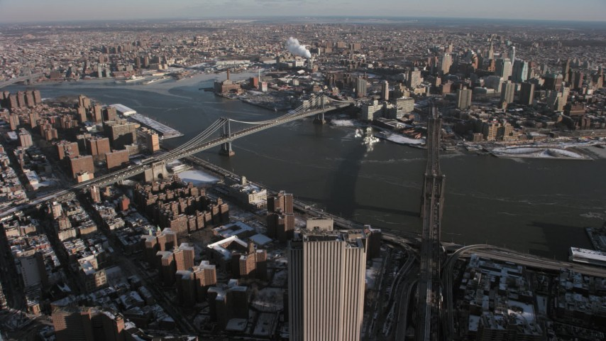 5K stock footage aerial video orbit the Brooklyn Bridge and Manhattan Bridge, New York City Aerial Stock Footage | AX66_0141