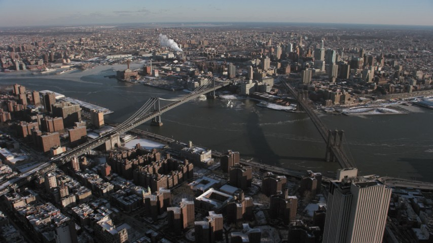 5K stock footage aerial video an orbit of Brooklyn Bridge and Manhattan Bridge, New York City Aerial Stock Footage | AX66_0142