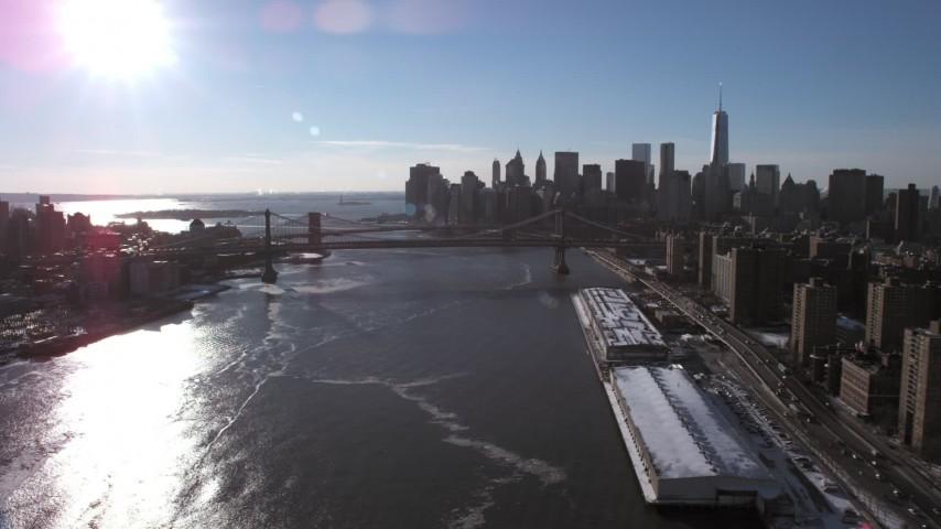 Manhattan Bridge and Lower Manhattan Skyline, New York City Aerial Stock Footage | AX66_0145