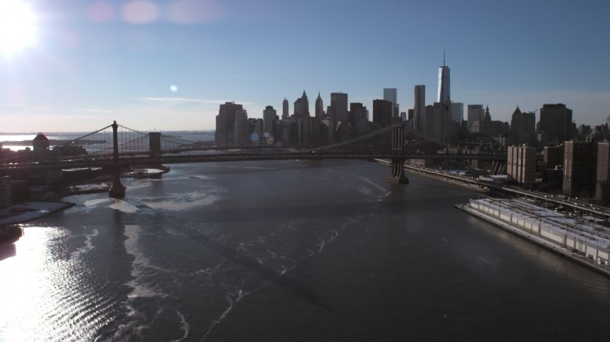5K stock footage aerial video approach the Manhattan Bridge and Lower Manhattan skyline, New York City Aerial Stock Footage | AX66_0146
