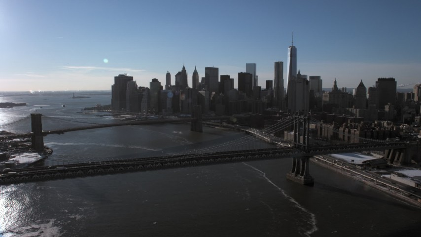 5K stock footage aerial video fly over Manhattan Bridge to approach Lower Manhattan skyline, New York City Aerial Stock Footage | AX66_0147
