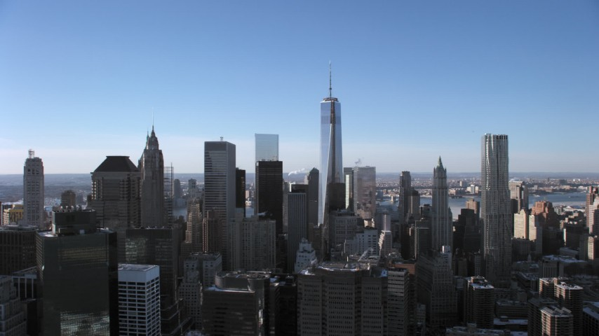 5K stock footage aerial video of flying by the Lower Manhattan skyline, New York City Aerial Stock Footage | AX66_0150