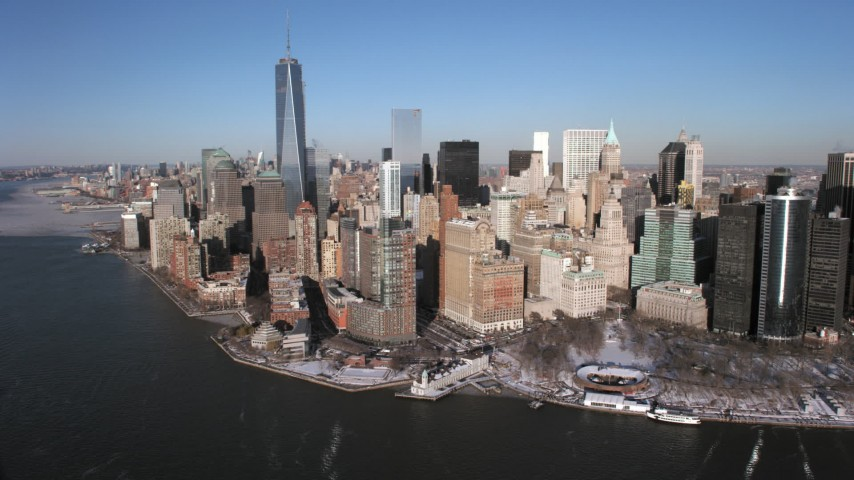 5K stock footage aerial video of One World Trade Center and Lower Manhattan skyscrapers in snow, New York City Aerial Stock Footage | AX66_0155