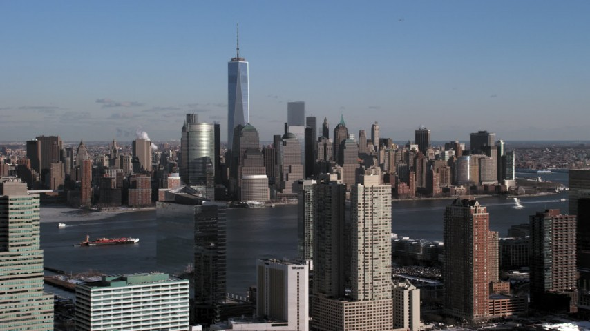 5K stock footage aerial video of Lower Manhattan skyscrapers across the Hudson, New York City Aerial Stock Footage | AX66_0164