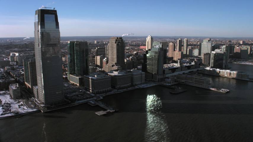 5K stock footage aerial video of Goldman Sachs Tower and skyscrapers in Downtown Jersey City, New Jersey Aerial Stock Footage   AX66_0173