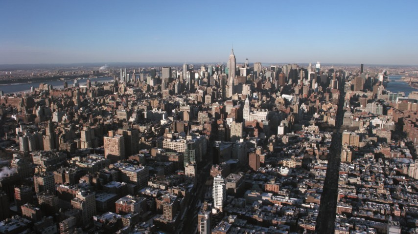 5K stock footage aerial video of a wide view of Midtown Manhattan skyscrapers in the distance, New York City Aerial Stock Footage | AX66_0179