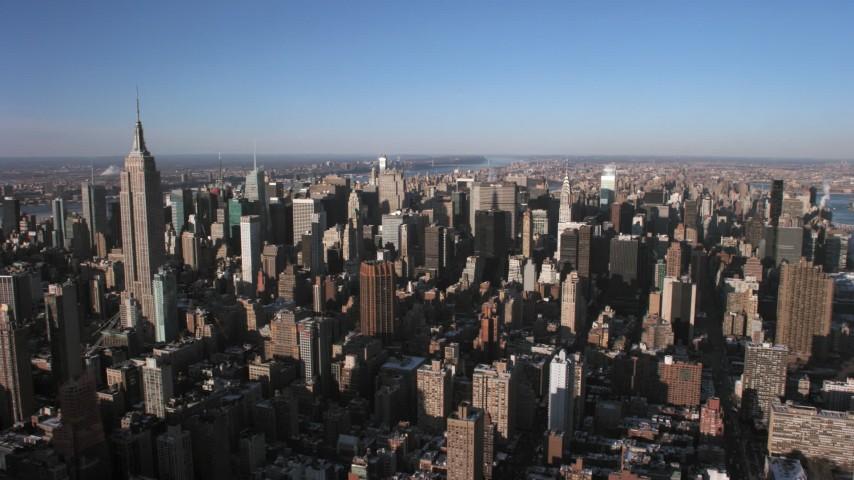 5K stock footage aerial video of flying toward Midtown Manhattan skyscrapers, New York City Aerial Stock Footage   AX66_0183