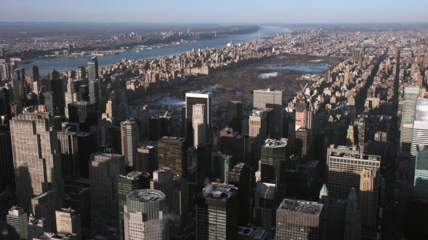 5K stock footage aerial video fly over Midtown Manhattan skyscrapers, approach Central Park, New York City Aerial Stock Footage | AX66_0186