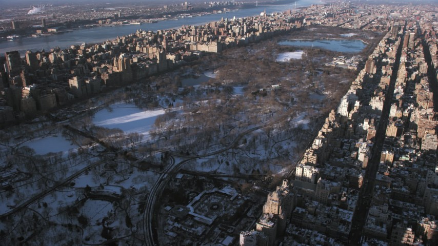 5K stock footage aerial video of Central Park in snow, New York City Aerial Stock Footage | AX66_0188