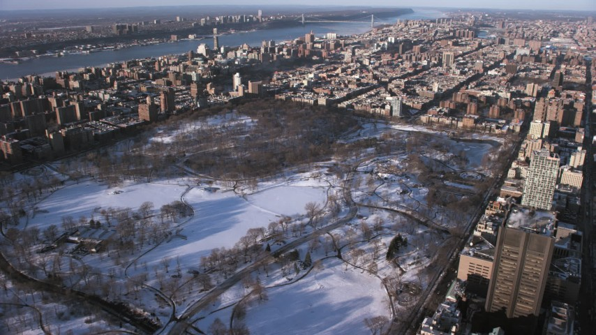 5K stock footage aerial video flyby Central Park in snow, approach Harlem, Manhattan, New York City Aerial Stock Footage | AX66_0193
