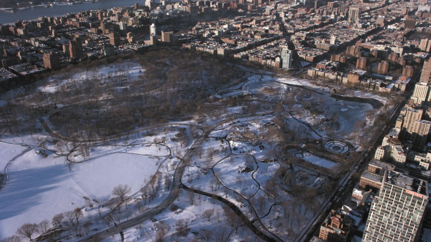 5K stock footage aerial video of Central Park skating rink in snow, Manhattan, New York City Aerial Stock Footage | AX66_0194