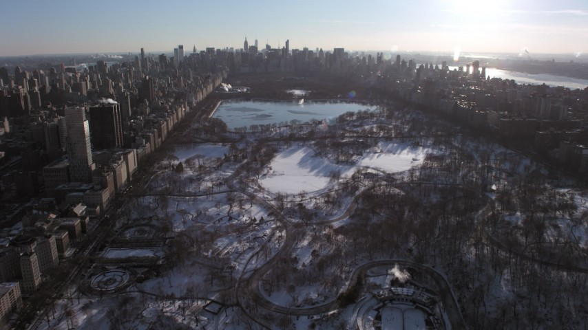 5K stock footage aerial video of flying over Central Park in snow, New York City Aerial Stock Footage | AX66_0197