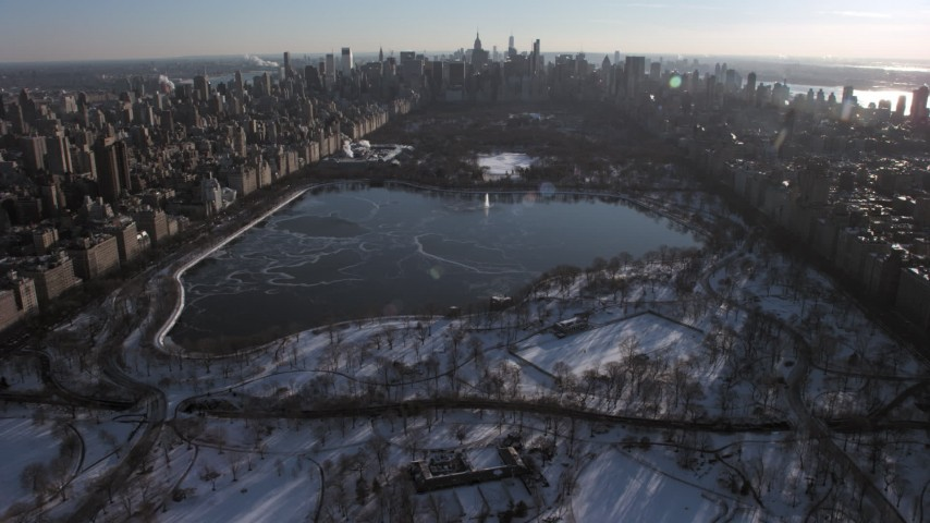 5K stock footage aerial video approach lake in snowy Central Park, Manhattan, New York City Aerial Stock Footage | AX66_0199