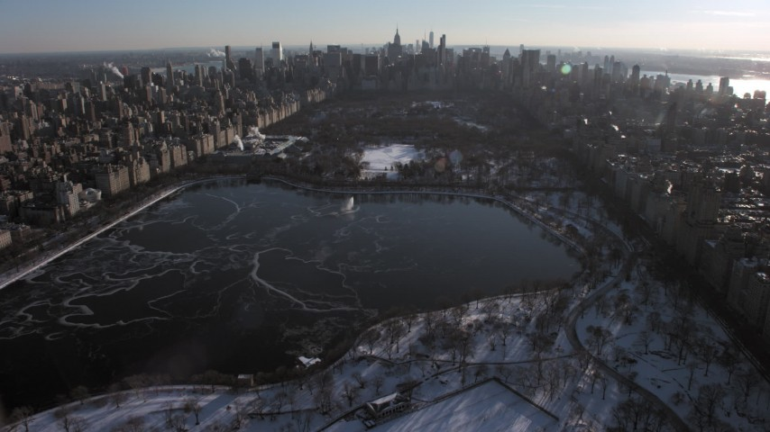 Central Park and Midtown Manhattan in snow, New York City Aerial Stock Footage | AX66_0200