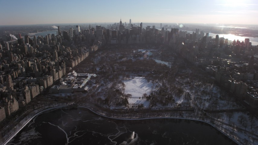 Central Park and Metropolitan Museum of Art in snow, New York City Aerial Stock Footage | AX66_0201