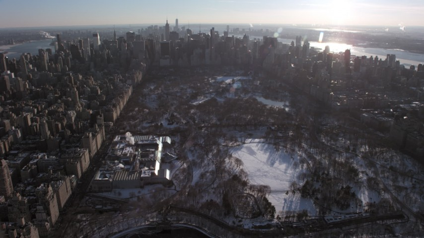 5K stock footage aerial video of Central Park and Metropolitan Museum of Art in snow, New York City Aerial Stock Footage | AX66_0201