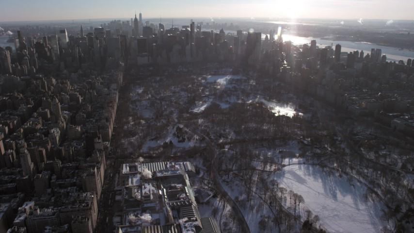 5K stock footage aerial video fly over Central Park and The Met in snow, approach Midtown, New York City Aerial Stock Footage | AX66_0202