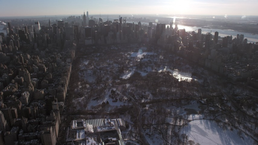 Midtown Manhattan Skyscrapers and Central Park in snow, New York City Aerial Stock Footage | AX66_0203