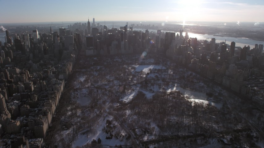 5K stock footage aerial video approach Midtown Manhattan skyscrapers from Central Park in snow, New York City Aerial Stock Footage | AX66_0203