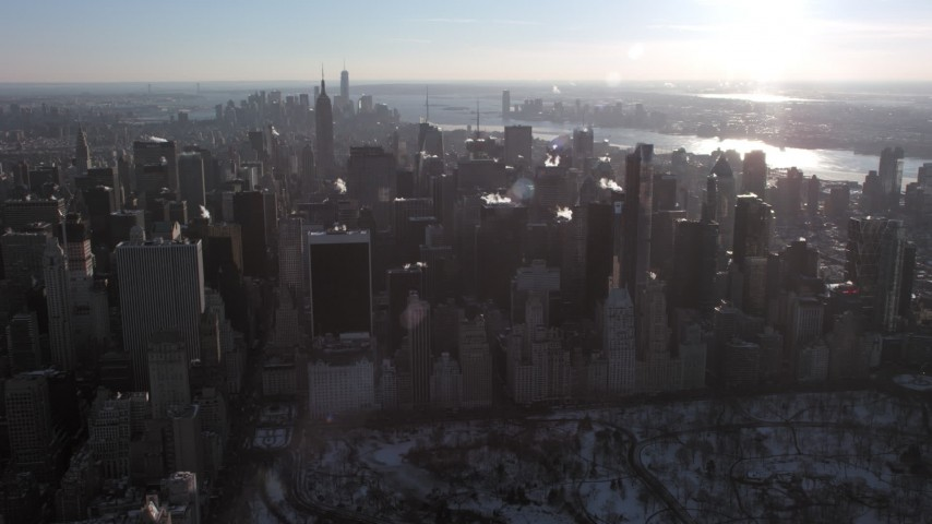 5K stock footage aerial video of flying by Midtown Manhattan's tall skyscrapers in New York City Aerial Stock Footage   AX66_0207