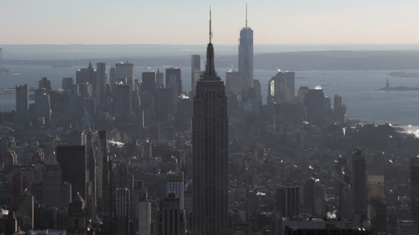 5K stock footage aerial video of the Empire State Building, with Lower Manhattan in the background in winter, New York City Aerial Stock Footage | AX66_0210