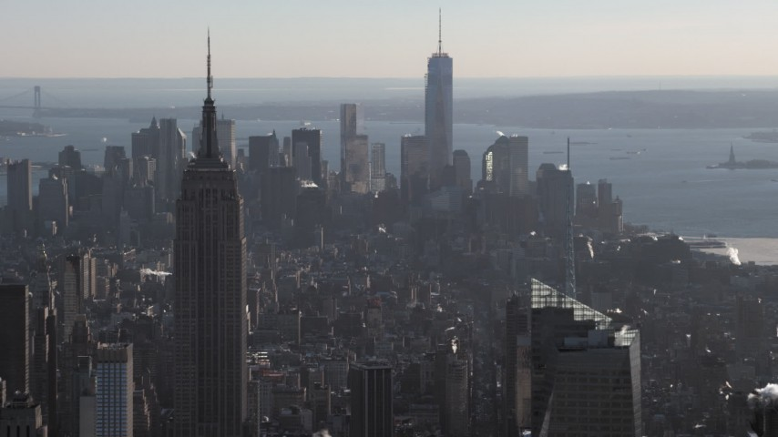 5K stock footage aerial video passing Empire State Building with view of Lower Manhattan skyscrapers in winter, New York City Aerial Stock Footage | AX66_0211