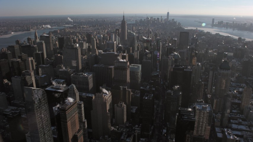 5K stock footage aerial video of Midtown, with Lower Manhattan in background in winter, New York City Aerial Stock Footage | AX66_0212