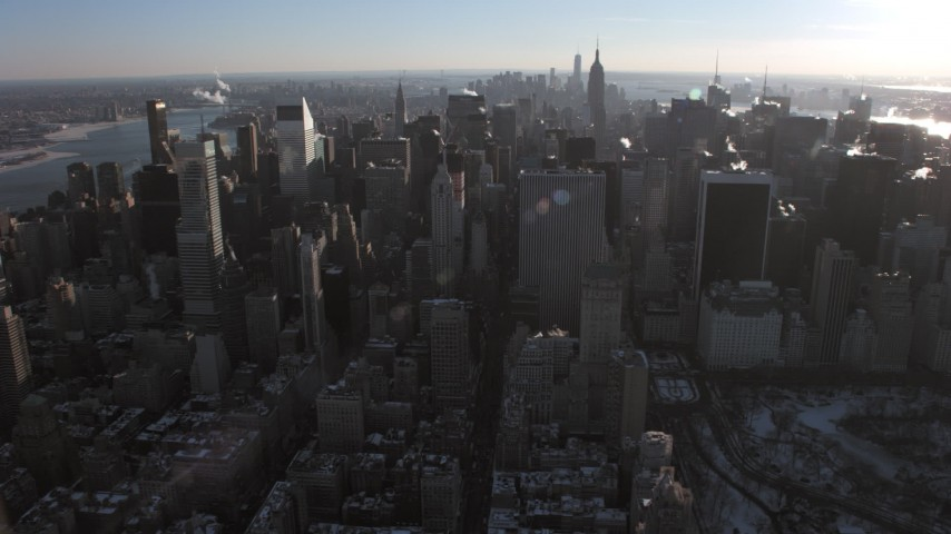5K stock footage aerial video flyby Midtown Manhattan's skyscrapers in winter, New York Aerial Stock Footage | AX66_0215