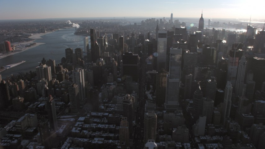 5K stock footage aerial video of Midtown skyscrapers and the East River, New York Aerial Stock Footage | AX66_0216