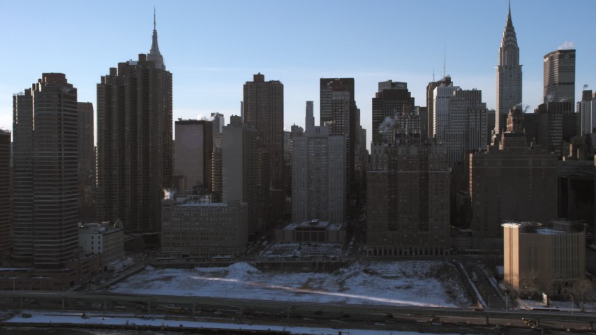 Midtown Manhattan Skyscrapers and Empire State Building, New York City Aerial Stock Footage | AX66_0222