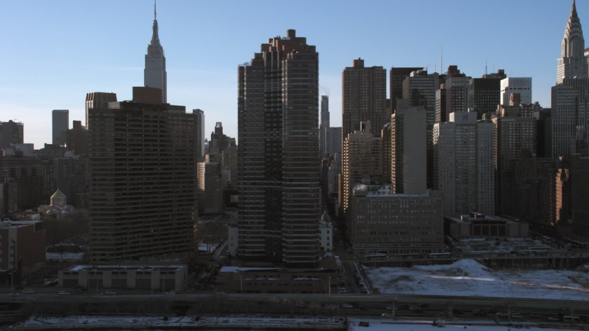 5K stock footage aerial video slowly flyby Midtown skyscrapers and Empire State Building, New York City Aerial Stock Footage | AX66_0222
