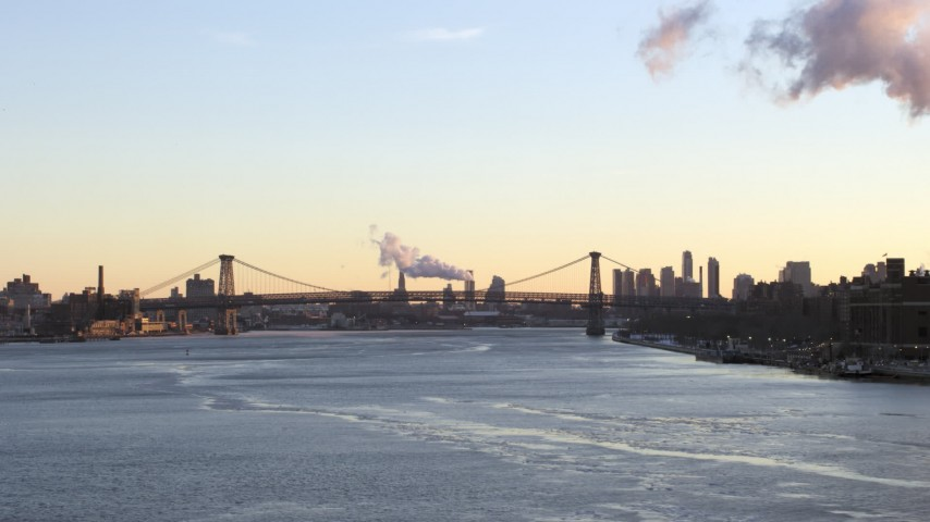 5K stock footage aerial video of flying toward Williamsburg Bridge on East River, New York City, sunset Aerial Stock Footage | AX66_0227